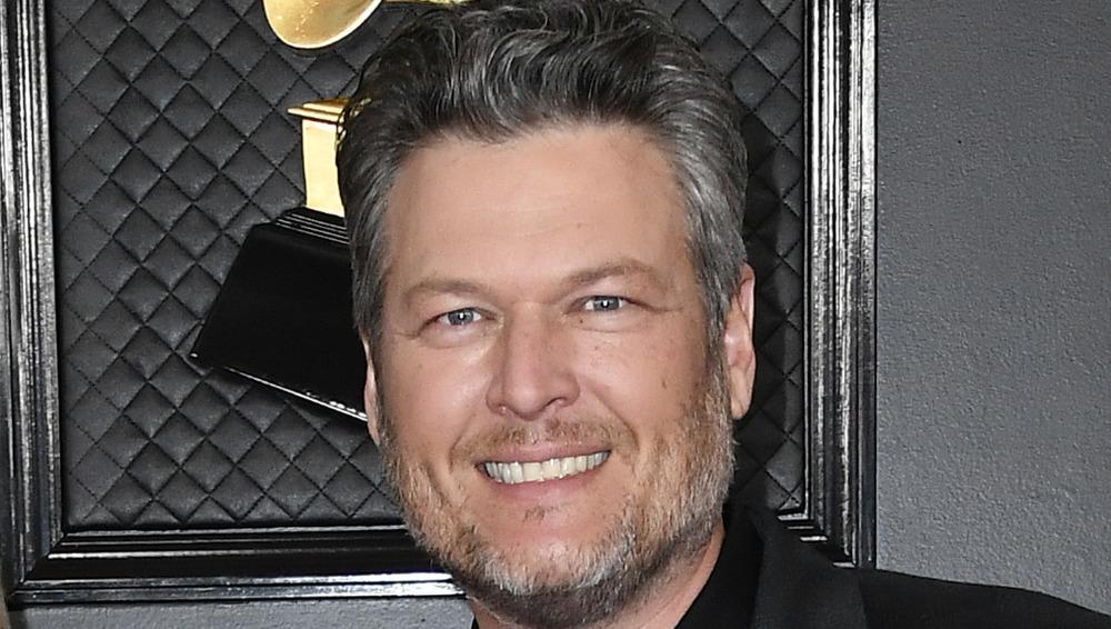 Blake Shelton smiling on red carpet