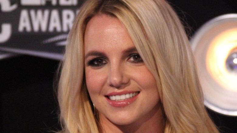 Britney Spears wears a black dress