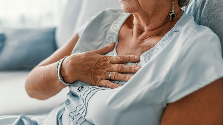 Woman experiencing heart pain
