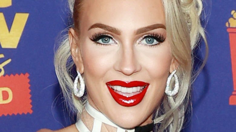 Christine Quinn on red carpet wearing red lipstick
