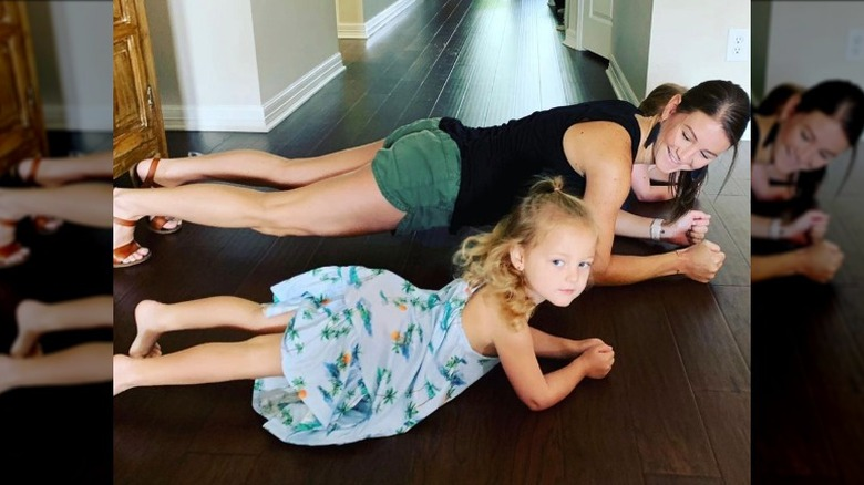 Danielle Busby doing planks at home