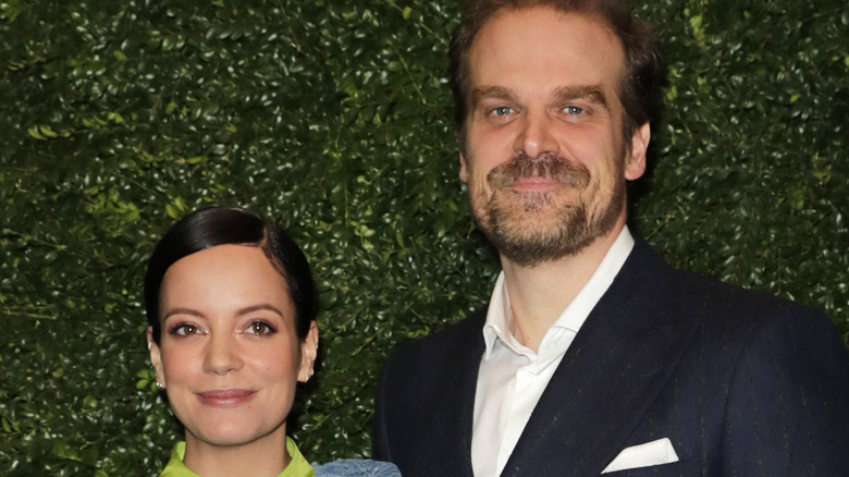 Lily Allen and David Harbour pose for a picture at an event