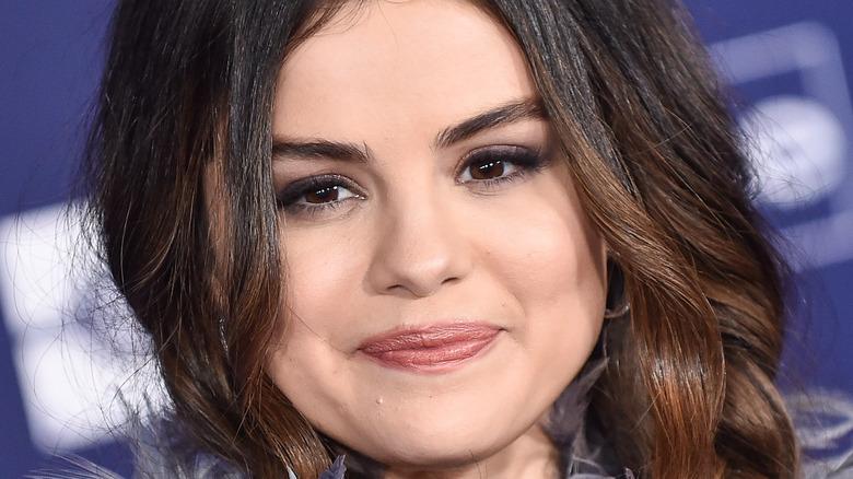 Selena Gomez with a slight smile