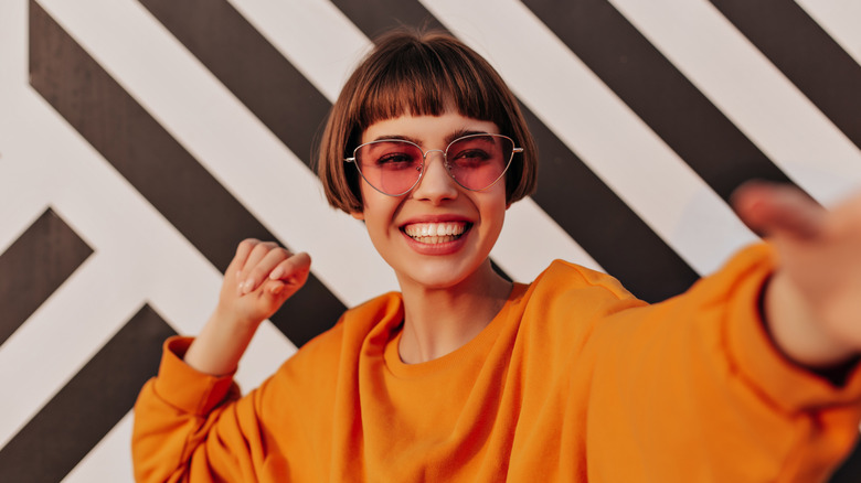Woman smiling in orange outfit