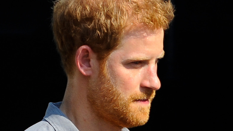 Prince Harry's profile, looking down