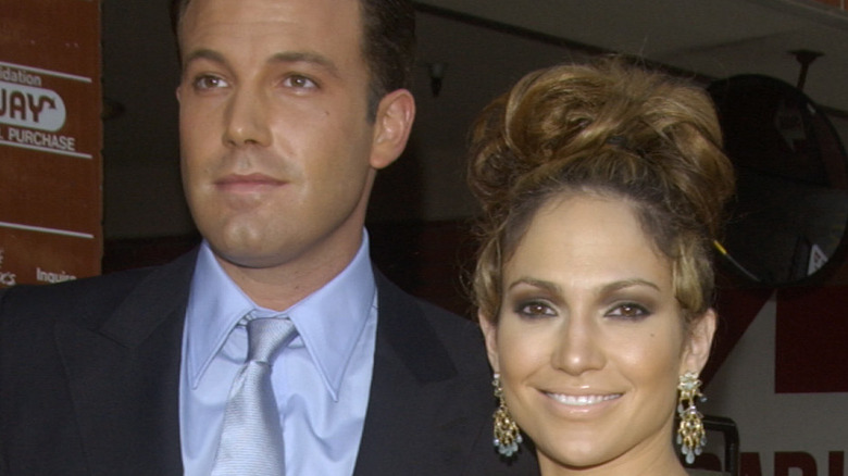 Jennifer Lopez and Ben Affleck posing on red carpet