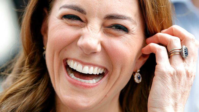 Kate Middleton smiles wearing engagement ring