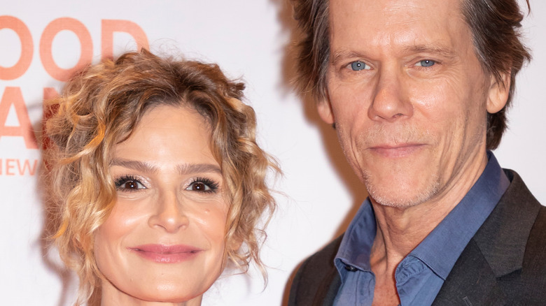 Kevin Bacon and Kyra Sedgwick smile at an event