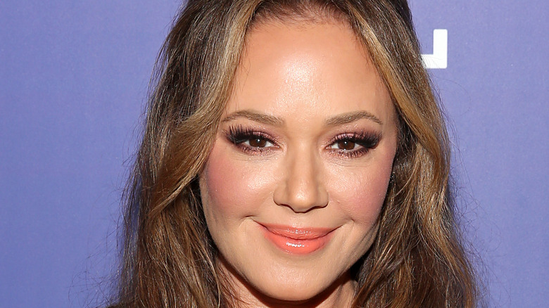 Leah Remini smiles at an event