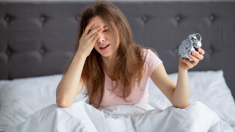 Woman feeling sleepy in the morning