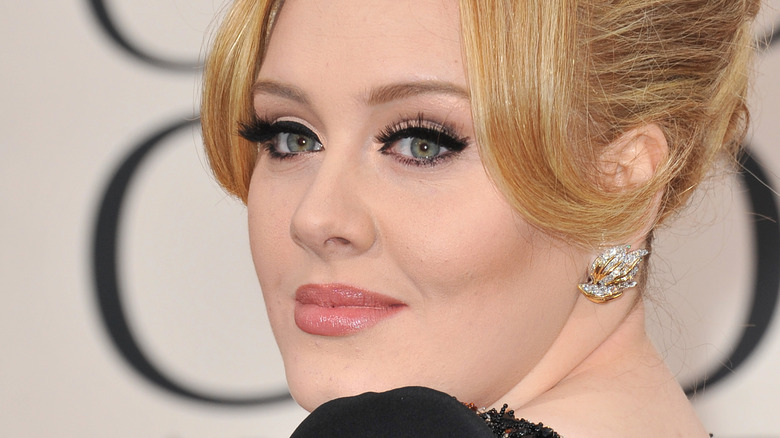 Adele posing on red carpet