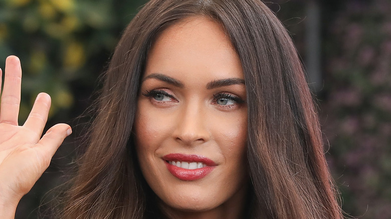 Megan Fox smiling to the side