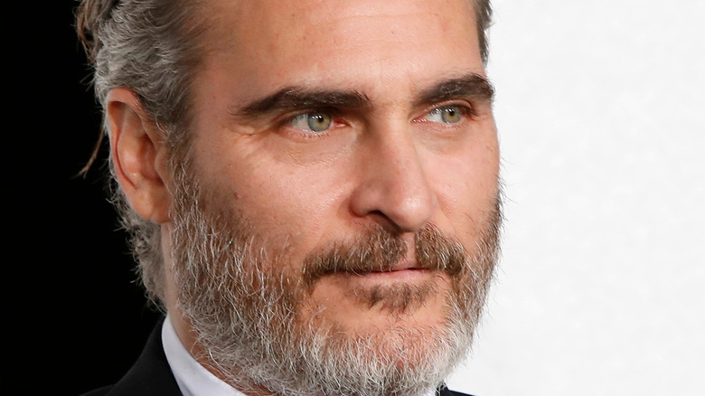 Joaquin Phoenix looking serious with facial hair