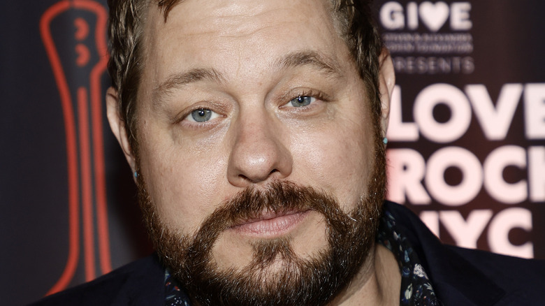Nathaniel Rateliff posing at event