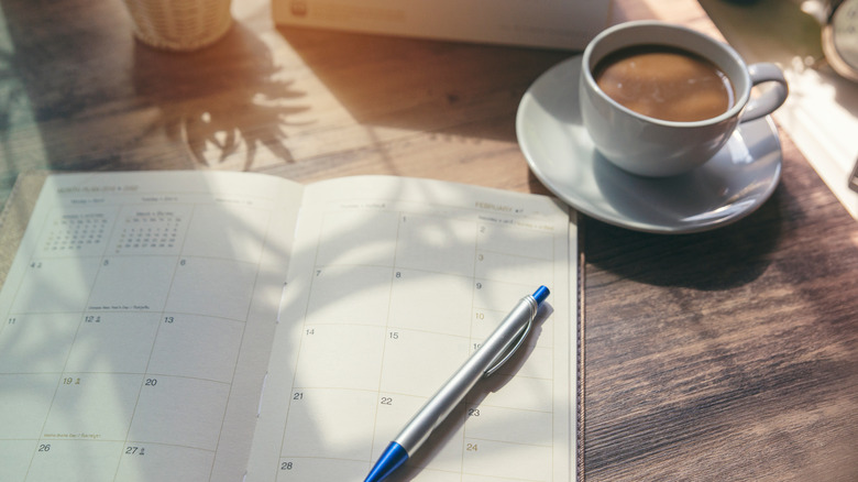 cup of coffee and an open day calendar