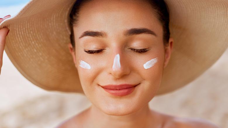 Women win sunscreen on face