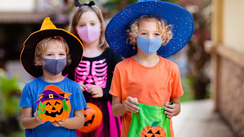 Three children going trick-or-treating