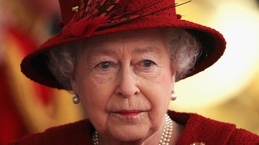 Queen Elizabeth II in a red hat