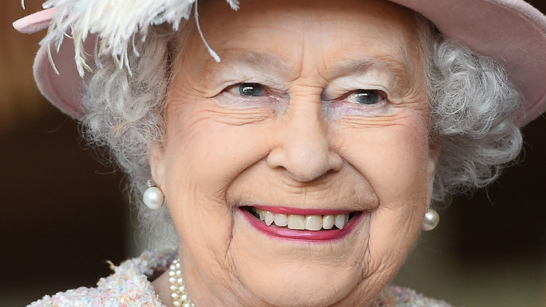 Queen Elizabeth II grinning widely