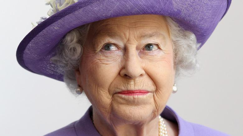 Queen Elizabeth II wearing light purple