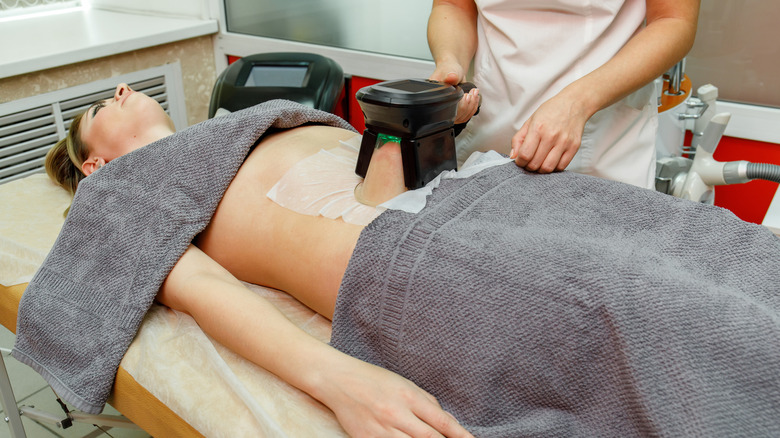 CoolSculpting treatment on a woman's stomach