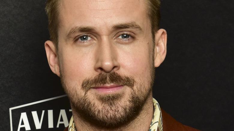 Ryan Gosling looking serious with facial hair
