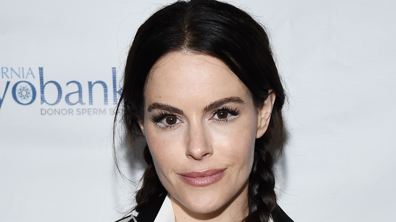 Emily Hampshire smiles on red carpet