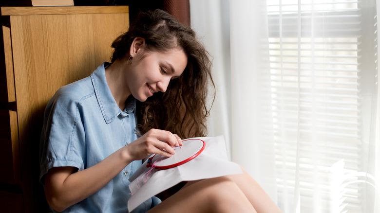 woman cross stitching
