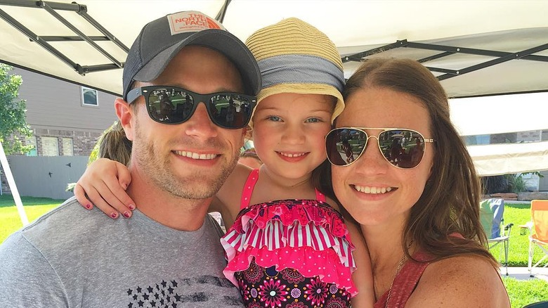 Adam and Danielle Busby from OutDaughtered with their daughter Blayke