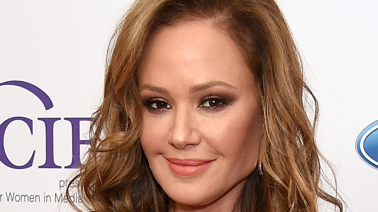 Leah Remini poses on the red carpet