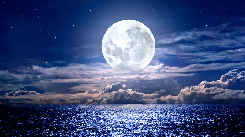 A full moon over the sea.