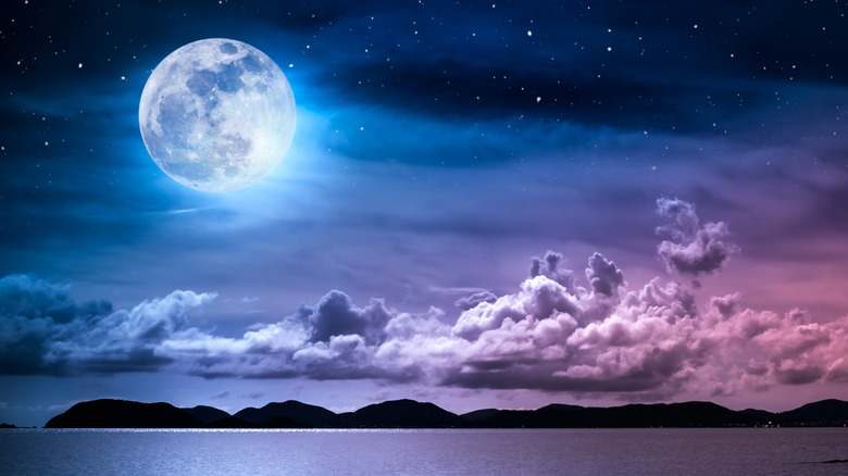 A full moon in the sky at night