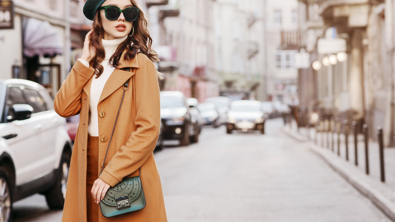 Woman posing with small purse