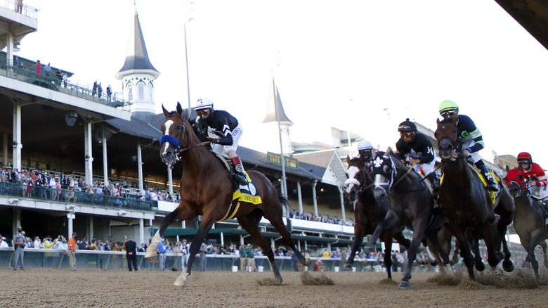 File: Kentucky Derby horses running