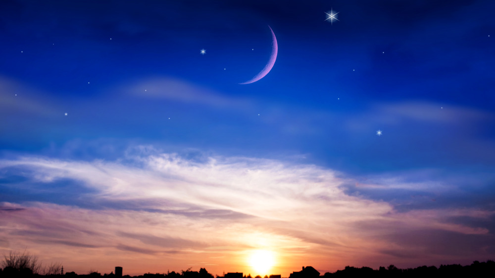 New moon with setting sun