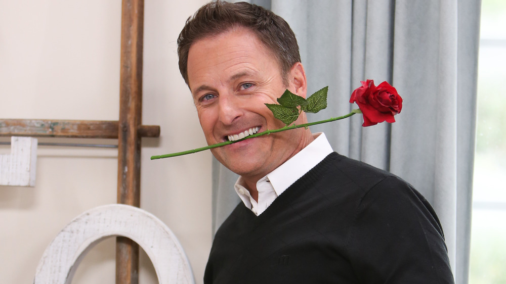 Chris Harrison with rose in mouth