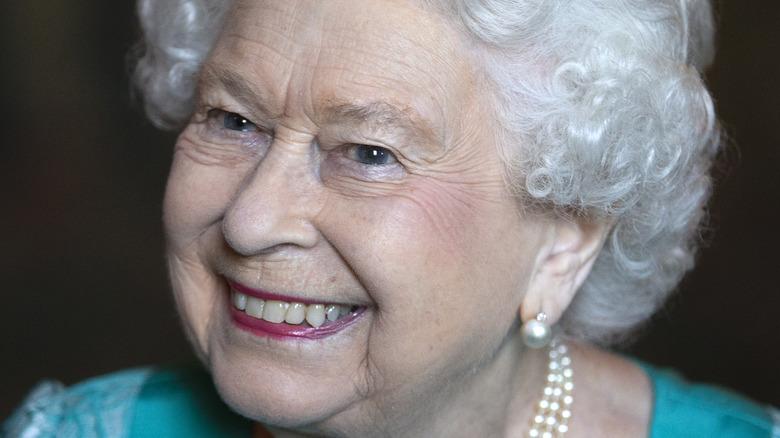 Queen Elizabeth smiles