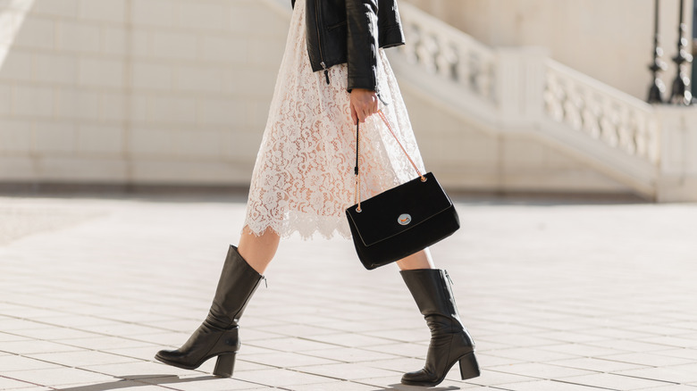 woman in lace dress and leather boots
