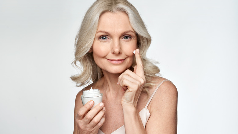 mature woman with an antiaging skin care routine