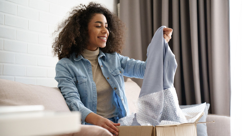 Woman unwrapping clothing