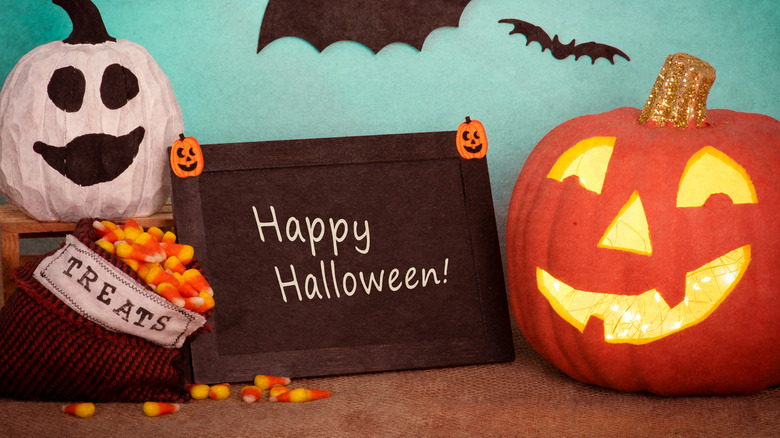 """""""Happy Halloween"""" sign amongst other decorations"""