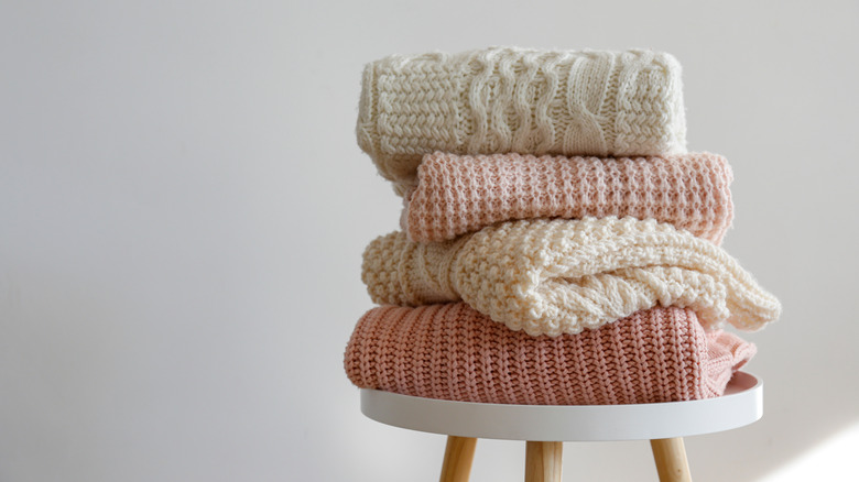 Sweaters on a chair