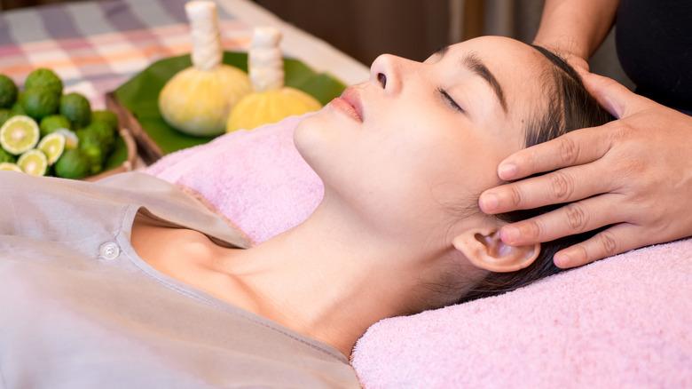 woman lying down head massage
