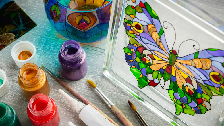 Colorful butterfly painted on glass
