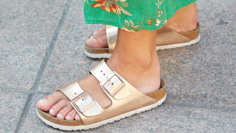 Gold Birkenstock sandals styled