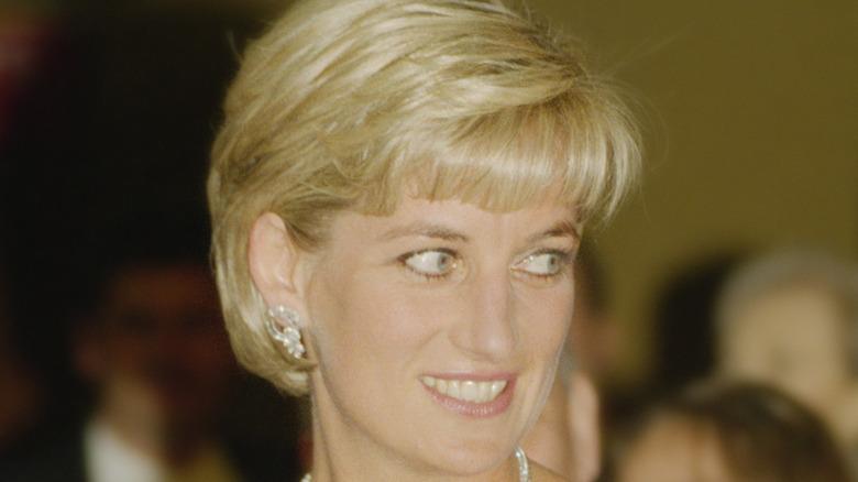 Princess Diana looking left