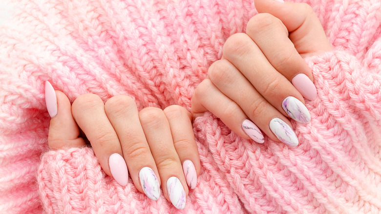 manicure with marble polish and sweater