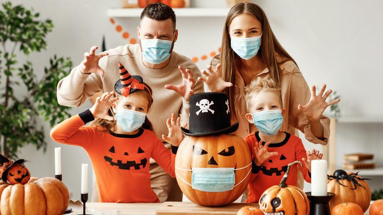 Family Halloween party with jack-o-lantern