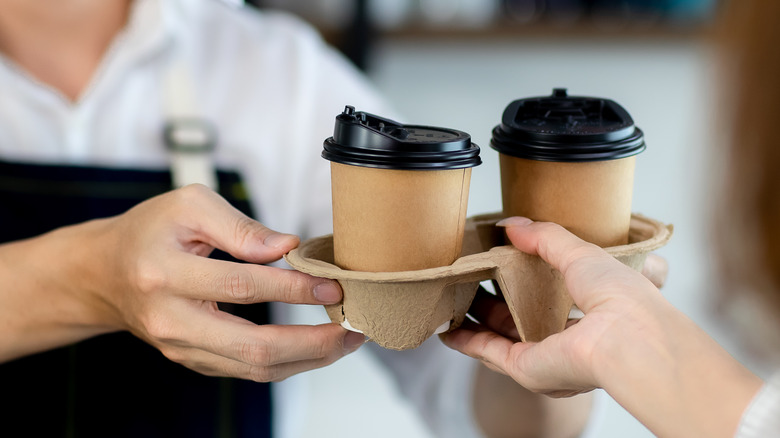 Coffee being handed to someone
