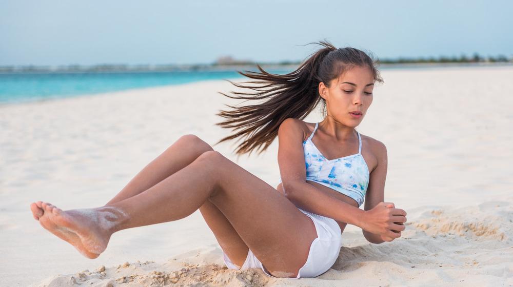 Woman exercising on beach